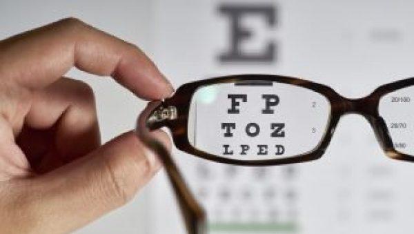 Eye exam chart shown through glasses lens