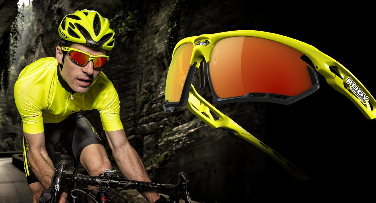 Man cycling with rudy project yellow cycling sunglasses