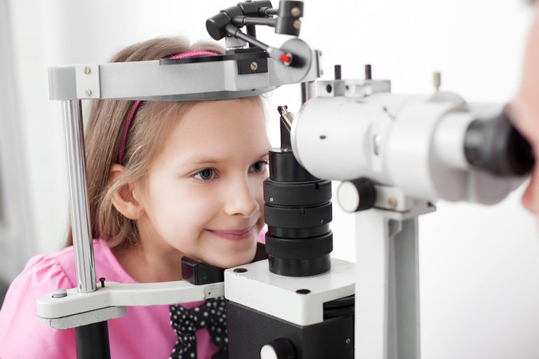 Picture of a child receiving an eye exam and being tested for dry eyes